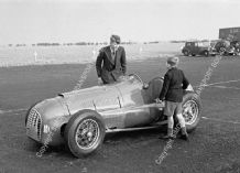 Ferrari 166 V12 Bill Dobson & Youngster in paddock. Winfield July 1951